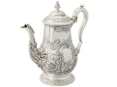 'Sterling Silver Coffee Pot' A very fine and impressive antique George IV English sterling silver coffee pot.