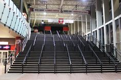 The Canadian Tire Centre was in need of a way to fix their very weathered steps. Mural Magic was called upon to create a strong base coat of special epoxy black paint to weather the traffic. Vinyl stickers were then applied on top. Canadian Tire Centre, Base Coat, Mural Painting, Ottawa, Epoxy, Murals, How To Apply, Strong, Weather