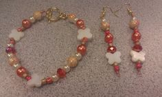 Orange and white Bead earring and wire bracelet by DoubleDzBeadz, $5.00