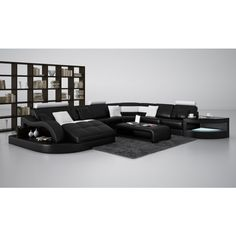 This modern black and white sectional sofa features a durable long-lasting construction. Initial price reflects the bonded leather upholstery where your body touches such as the headrests, backrests, seats, and armrests with an indistinguishable leather match material elsewhere to help keep the costs down. An option to upgrade to genuine leather with leather match is available. This sofa may also be ordered in other colors. Please call for further assistance