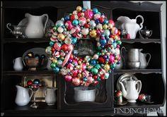 ornament wreath over cupboard