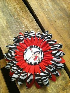 Large Red and Zebra Daisy Hair Flower with Betty Boop Bottlecap Center. $7.00, via Etsy.