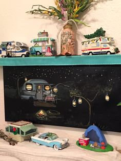 I hand painted the night camping scene and have repainted some of the camper nic-naks