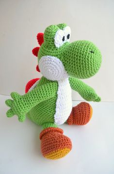 Funky DIY crochet patterns on Etsy: Yoshi doll at Amiamour