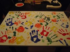 sentimental, homemade wall art on canvas... family members all contribute their handprints, sign the corner, and date it!  I like.