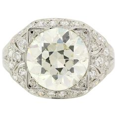 Art Deco E.G.L. Certified 4.55 carats Old European Cut Diamond Platinum Ring | From a unique collection of vintage engagement-rings at https://www.1stdibs.com/jewelry/rings/engagement-rings/