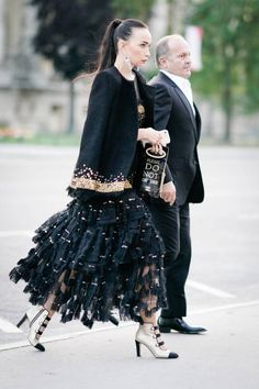 A guest wears a black lace dress outside the amfAR dinner at Petit Palais during Paris Fashion Week Haute Couture Fall/Winter 20172018 on July 2 2017...