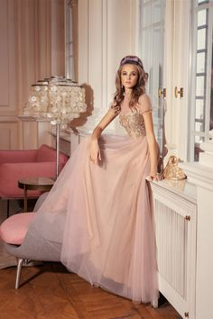 Style is a stunning gown of rode and gold with a high neck, decadent bodice, and puff sleeves. Evening Gowns With Sleeves, Long Evening Gowns, Bridal Dresses, Prom Dresses, Formal Dresses, Short Cocktail Dress, Cocktail Dresses, Beautiful Dresses, Nice Dresses