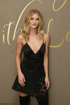 Rosie Huntington-Whiteley wearing Burberry black dress at the Burberry Festive Film premiere in London. (October 2015). #burberry