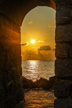 "gyclli: ""  Cefalu, Sicily, Italy   Sunset over the rocks *** By Marie Hélène """