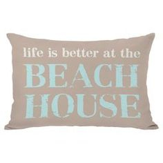 Add a beach-chic touch to your favorite nook or arm chair with this plush indoor/outdoor pillow.  Product: PillowConstruction Material: 100% Premium polyester cover and 100% premium polyester down alternative fillColor: Tan and aquaFeatures:  Insert includedSuitable for indoor and outdoor useMade in the USA Sewn closureDimensions: 14 x 20Cleaning and Care: Removable cover is machine washable
