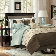 The Madison Park Serene 7-Piece Comforter Set was specifically designed to create a sense of serenity in your bedroom. The bedding uses piecing details and an embroidered floral pattern on a soft blue, brown, and taupe background for a soothing look.