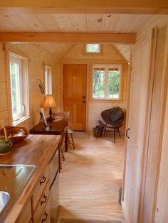 It's appointed with the usual amenities, including a basic kitchen, storage closets with a washer/dryer combo, recessed lighting, a composting toilet and a tub with shower surround. #TinyHouseforUs
