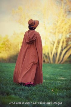 © Susan Fox / Trevillion Images - woman-in-cape-and-bonnet-in-field