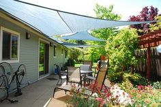 Shade sails are triangular or square pieces of high-strength nylon that you suspend over your patio, adding color, pattern, and plenty of shade. The sails require connections to posts, trees, or rigid structural members of your house, such as exposed rafter ends.