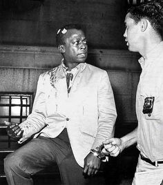 Miles Davis, beaten up and arrested for smoking a cigarette and ignoring an order to walk on, on Birdland's boardwalk, on August 26, 1959.