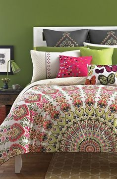 Mediterranean style print. Great wall color does not overpower due to bed linens.