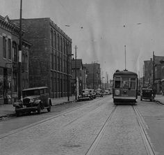 Oakley and Grand Avenue (Chicago, IL), Oct. 14, 1939: A streetcar travels west in a photo taken for a follow-up story about a shooting of a streetcar conductor. The conductor was shot by a person sitting in a parked car on the north side of Grand Avenue in the block shown. (Vintage Tribune)
