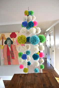 Pom Pom chandelier! (DIY instructions can be found here: http://smallforbig.com/2013/05/diy-pom-pom-chandelier-neon-yarn-craft-mobile.html)