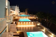Night shot of the La Residence 5 Star Luxury Hotel Suites in Mykonos outdoor swimming pools. The swimming pools are ideal for sharing with family and friends.