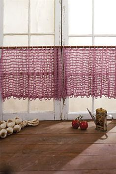 Ravelry: Curiously Easy Lacy Curtains pattern by Doris Chan  I really like these - could totally see them in my kitchen window.