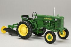 John Deere Model M with plow by SpecCast. Featuring free rolling wheels and accurate details make this an excellent display piece. LP51572 Age Grade: 14+