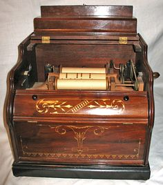 Imperial Celstina Paper Roll Organ...amazing music box from the past