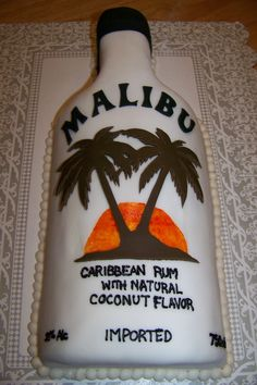 Malibu rum bottle cake. Vanilla cake with buttercream filling. Covered...