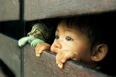 adorable photo of a child and a cat photo
