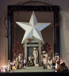 Willow Tree Nativity Display  Love the large star behind the nativity scene!