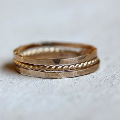 Solid gold stacking rings. Hammered and textured 14k gold stacking rings. These unique solid 14k yellow gold stacking rings make a one of a kind wedding ring or an awesome everyday ring. Wear them all