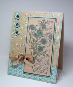 Stamps:  Letters and Flowers (Penny Black) Paper:  Kraft, blue, brown, Madeline DP by Prima  Ink:  Memento Tuxedo Black   Accessories:  Copic Markers:  BG10, BG13, YG 95, YG 17, E25, Chocolate Pearls (Kaiser), Caramel Twill ribbon  & Caramel string (American Crafts), button (Basic Grey)