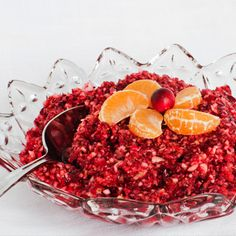 Lighten Up Thanksgiving With This Cranberry Relish 1 bag raw cranberries 1 cored,unpeeled, chopped red apple 1 whole, seedless, UNpeeled orange chopped 1/4 C walnuts 2/3 C maple syrup 1 T cinnamon 1 t cardamon 1/2 t nutmeg pulse, blend in food processor. Serve chilled.