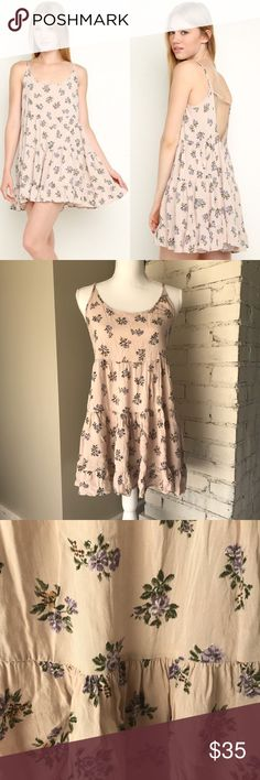 Brandy Melville Blush Lavender Floral Jada Dress This rare Brandy Melville jada dress is a beautiful dusty rose color with lavender flower clusters and green leaves. The jada dress has an open back with adjustable straps. This dress is in good used condition with no stains or holes. The adjustable straps are twisted up but it does not affect wear and isn't noticeable when worn. Offers are welcome through the offer button! Brandy Melville Dresses Backless