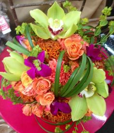 Cymbidium orchids, celosia, dendrobium orchids, spray roses, lily grass,...