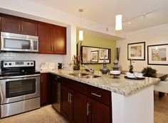 Enjoy gourmet kitchens with stainless steel appliances at AMLI Toscana Place apartments in Davie, FL