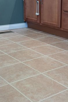 Make your tiled floor look brand new again! This tutorial has the easiest tips and tricks to paint your tile grout with just a few simple steps. Avoid the hassle of cleaning your dirty grout lines and find the best paint products to freshen up your grout. Grout Paint, Tile Grout, Sanded Grout, Powder Room Paint, Grout Repair, Easy Tile, Floor Grout, Paint Combinations, Painting Tile Floors