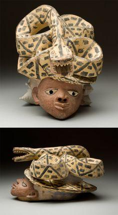 Africa | 'Gelede' or 'Efe' helmet mask from the Yoruba people of Nigeria / Benin | Wood, pigment | ca. prior to 1963