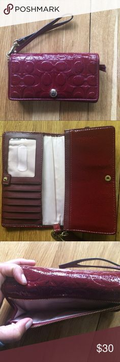 "Coach Red Patent Leather Wallet/ Wristlet Coach Red Patent Leather Wallet/ Wristlet. Approximate measurements 7"" wide, 4""long. Lightly used, a few scuffs can be seen in pictures. Perfect for a night out and fits iPhone 5s with case! Pet/smoke free home. Make an offer, no trades Coach Bags Wallets"