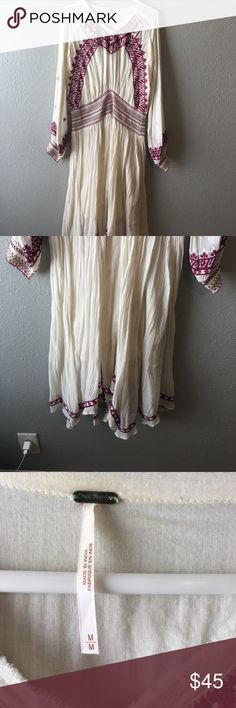 Free people peasant dress Free people peasant style dress with embroidered sleeves and hemline. It has elastic waistband which makes this very comfortable to wear. Free People Dresses Maxi