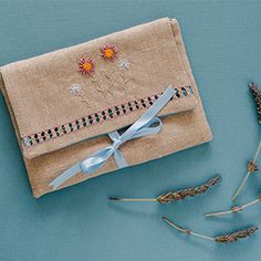 DMC Pearl Cotton size 12 is now available online by the skein. In celebration, we offer you this free pattern for a sweet, fashion-forward pouch.