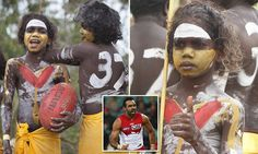 Aboriginal dancers paint themselves in Adam Goodes' Swans colours