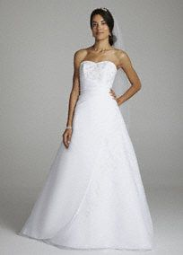 Stunning embroidery, classic A-line style, this organza gown really does have it all!  Strapless bodice features ultra-feminine sweetheart neckline and exquisite floral beading design.  Side draping creates a stunning silhouette while full A-line skirt is adorned with magnificent intricate embroidery.  Chapel train. Available in White.  Fully lined. Back zip. Imported polyester. Dry clean.