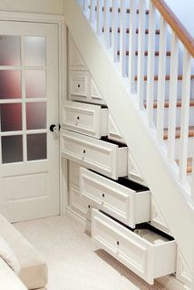 Nice built in drawers under stairs.