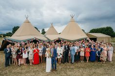 With miles of lavender rows set as the background, this wedding is full of color and happiness. Get inside their tipi tent to witness the lively party. on http://www.bridestory.com/blog/hitchin-lavender-farm-wedding