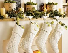 love these stockings and the mantel, it looks so fresh and happy!