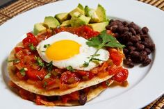 Paleo Huevos Rancheros (use grain free tortillas, crepes or tostones, use olive oil and replace beans with cubes of pork or beef)
