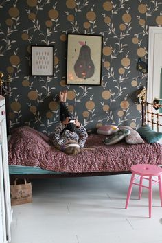 An original girls bedroom. Wallpaper can make such a dramatic change to a room.  I love the oversized floral print and the dark base colour. It works really well with the pink and teal bed without being matchy matchy and coordinated.