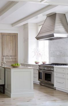 Kitchen Dreams. Serene: white with bleached wood floors and silver accents. Interior Designer: Phoebe Howard.