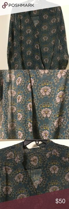 Beautiful blouse from Nordstrom XS floral blouse purchased from Nordstrom. Brand is Halogen. Blouse is semi sheer and has a snap button towards the top. Snap needs to be tightened but other than that is in amazing condition - worn once for a photo shoot. Elastic around the bottom and really cute elastic sleeves. Looks gorgeous on. Nordstrom Tops Blouses